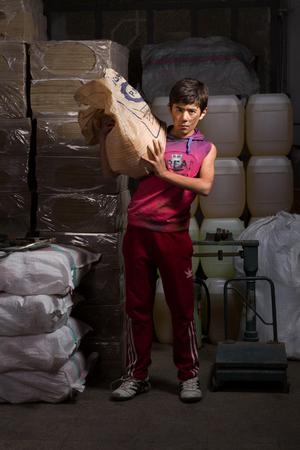 child in manufactory   Arsham Rezaei